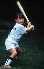 Girl playing baseball; Size=180 pixels wide